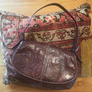 Cole Haan brown tooled leather shoulder bag.